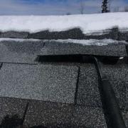 Winter Ice Damage ice lifting shingles then melting