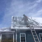Winter Ice Damage leaf blower exposes shingles